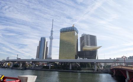flamme: Flamme dor building and Tokyo skytree tower near Sumida river and bridge in Asakusa, Tokyo.
