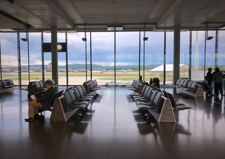 Zurich, Switzerland - May 14, 2017: Inside of concourse E at waiting area for passengers who travel from Zurich Airport to somewhere else. Stock Photo