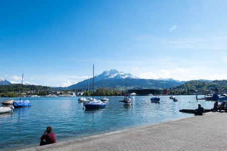 May 5, 2017 - Luzern, Switzerland: landscape of port at Luzern park. People are likely to relax themselves under the sun.