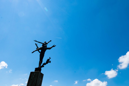 Statue of freedom under sunny blue sky at Lucern, Switzerland. Abstract background. Editorial