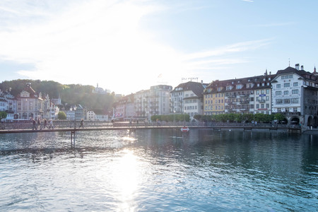 May 5, 2017 - Luzern, Switzerland: Rathaussteg, concrete bridge where people walk and ride bicycles across Reuss river.Shot in soft focus. Editorial