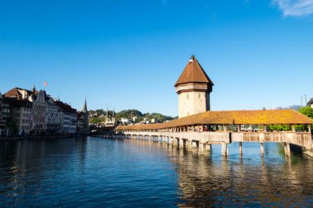 May 6, 2017 - Lucerne, Switzerland: Kapellbrucke or Chapel bridge, old wooden footbridge lays across the Reuss river in downtown of Lucerne.