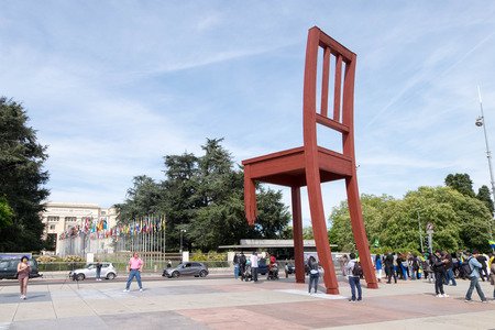 May 10, 2017 - Geneva, Switzerland: Red broken chair in front of United Nation headquarter office in Geneva. There were Gabon protesters making mob in peace as well.