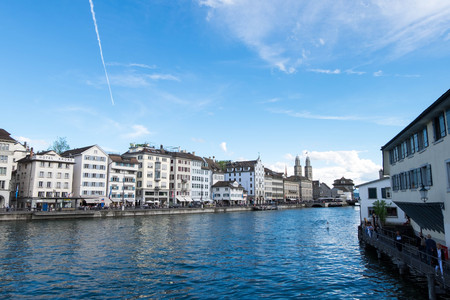 May 13, 2017 - Zurich, Switzerland: View of Limmat river and building along riverbank. Twin tower is Wasserkirche or Water church of Zurich.
