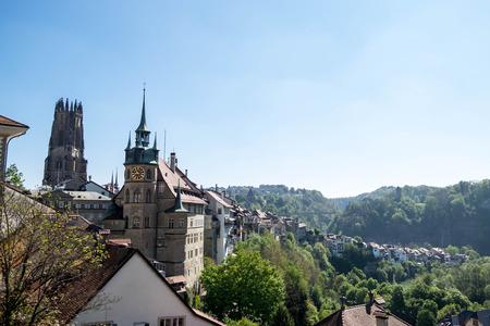 May 10, 2017 - Fribourg, Switzerland: Cityscape of Fribourg town with City Hall and The Gothic cathedral of St. Nicholas tower.
