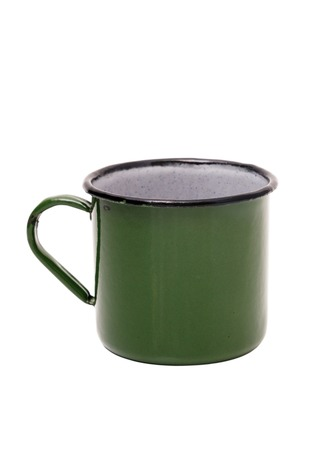 Old green tin Cup on white background. Green vintage metal mug isolated on white background.