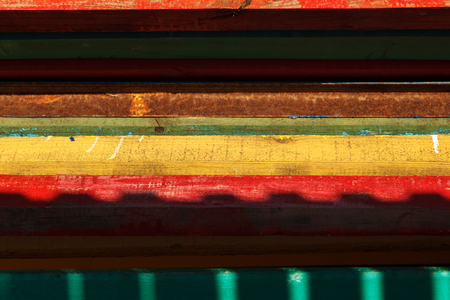 Colorful beach benches stacked in a pile, close-up. Abstract background, geometry. 写真素材