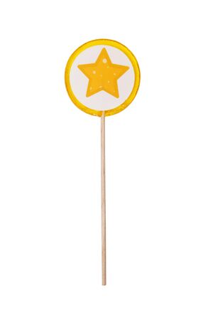 Lollipop with yellow star on white background close-up. Colorful handmade lemon Lollipop isolated on white background. Studio shot