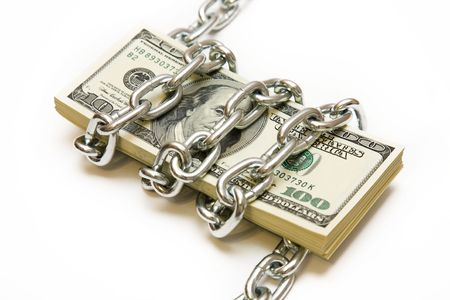 catenation: Shackled stack of dollars on the white background