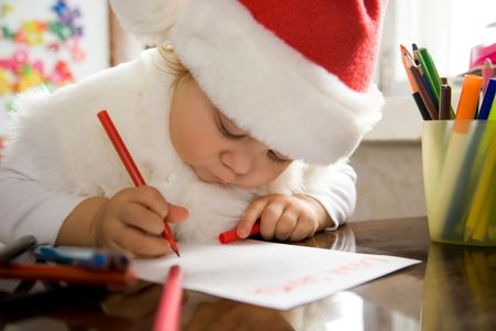 The small child writes the letter to Santa Stock Photo - 6353626