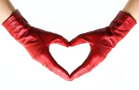 Two hands in red gloves connected in heart photo