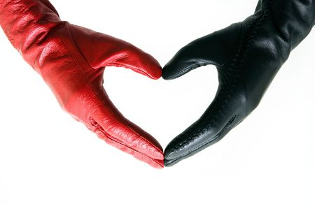 Mans and female hands in gloves connected in heart