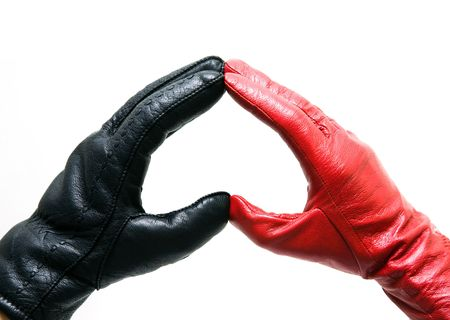 Man's and female hands in gloves connected in heart Stock Photo - 6353634