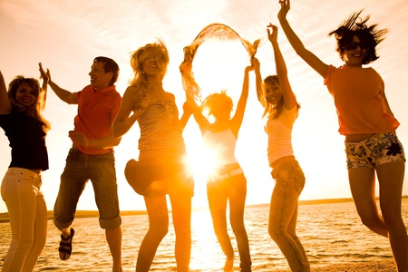 group of happy young people dancing at the beach on  beautiful summer sunset Stock Photo - 8685554