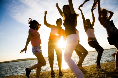 group of happy young people dancing at the beach on  beautiful summer sunset Stock Photo - 8685562