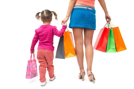 Woman during the shopping with the little girl photo