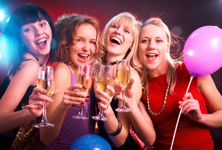 Portrait of happy young friends touching the glasses with each other Stock Photo - 9077562