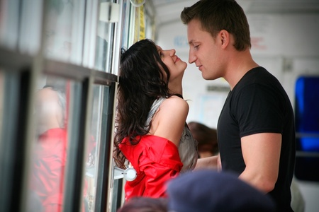 passionate dating a beautiful young couple in the cabin of the bus. photo