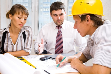 Meeting the team of engineers working on a construction project at the table Stock Photo - 9132036