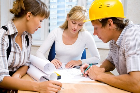 Meeting the team of engineers working on a construction project at the table Stock Photo - 9132047
