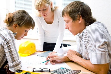 Meeting the team of engineers working on a construction project at the table Stock Photo - 9132243