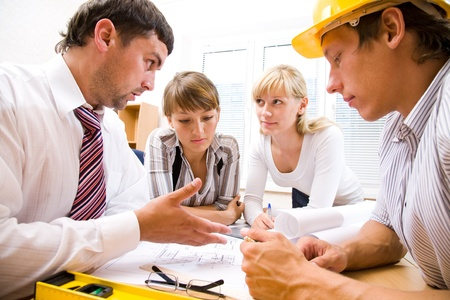 Meeting the team of engineers working on a construction project at the table Stock Photo - 9132035