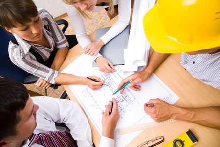 engineers: Meeting the team of engineers working on a construction project at the table. Up view Stock Photo