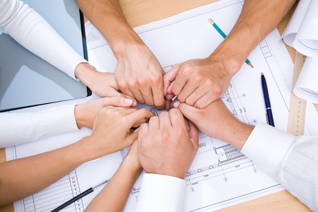 picture of hands to stay together over the table to show solidarity team Stock Photo - 9131969