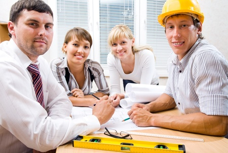Portrait  the team of engineers working on construction project at the table Stock Photo - 9132051