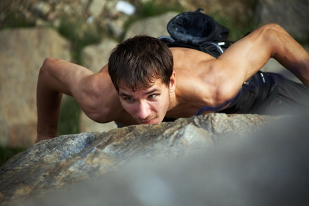 Photo of young man climbing up the rock Stock Photo - 9131869