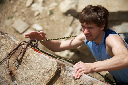 Photo of young man climbing up the rock Stock Photo - 9132041