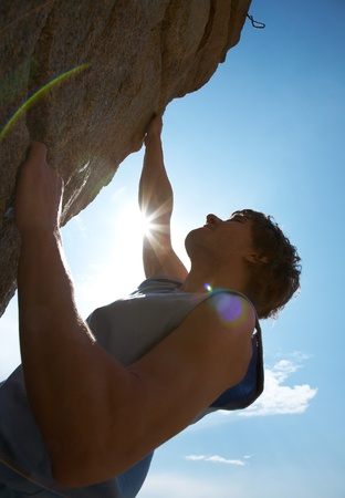 Photo of young man climbing up the rock  Stock Photo - 9131876