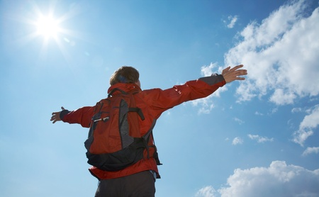reached: Happy man hiker holding his arms in the air in a feeling of success having reached the summit Stock Photo