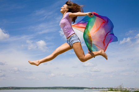 scarf beach: Beautiful young Woman enjoy and jumping on the beach  Stock Photo