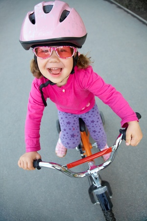portrait of a funny girl with a bicycle photo