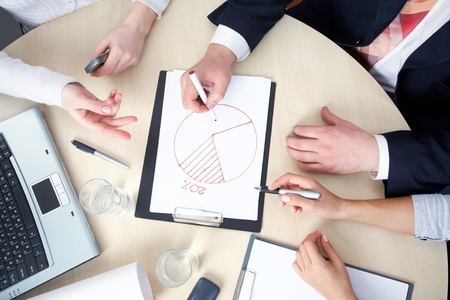 architecture plans: young businesswoman drawing graph on chart in office