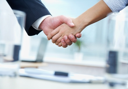 Clouse-up of businessman and  businesswoman shaking hands Stock Photo - 10229369