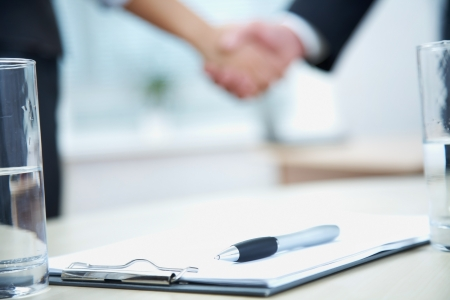 shaking: Clouse-up of businessman and  businesswoman shaking hands
