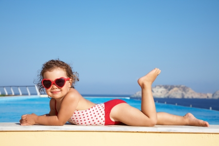 child girl nude: Beautiful little  girl sunning at the pool