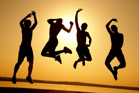 group of happy young people dancing at the beach on  beautiful summer sunset Stock Photo - 10229389