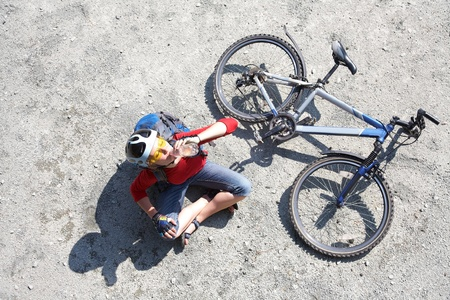 Young cyclist on a mountain bike drinks water  photo