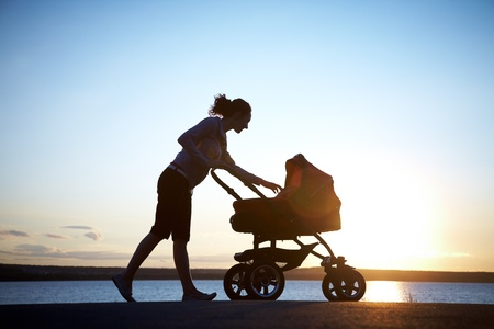 Silhouette of  young mother enjoying motherhood Stock Photo - 10430519