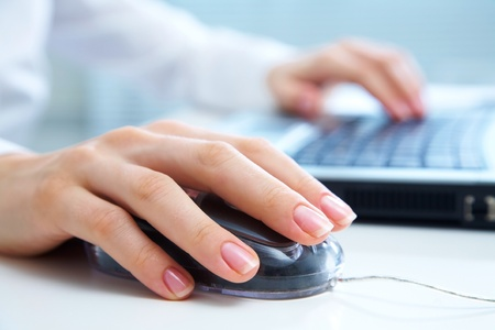 Detail of female hands using a computer on office background Stock Photo - 10430544