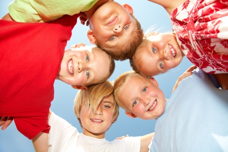 children playing outside: Group of different children having good summertime Stock Photo