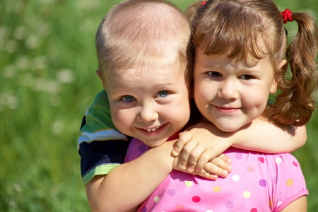 baby girl playing: Portrait of a cheerful girl and boy hugging fun in outdoor