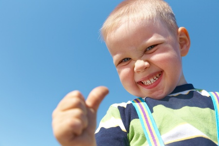 Portrait of happy joyful  little boy gesturing thumb up success sign   Stock Photo - 10430583