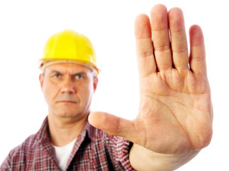 Close-up palm builder showing forbidding gesture stop photo