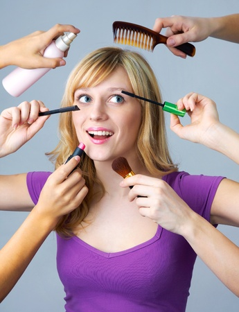Blonde woman doing makeup and hairstyle  photo
