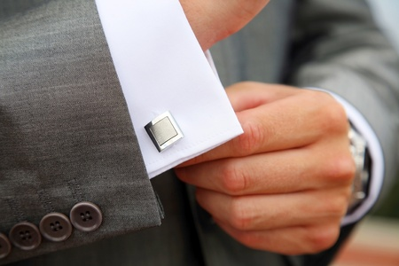 A man fastening a cuff-link before getting married Stock Photo - 10491196