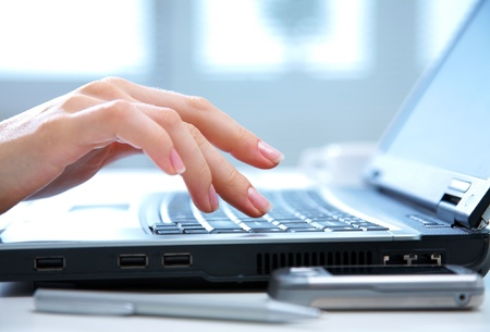 wireless tool: Human hands working on laptop on office background